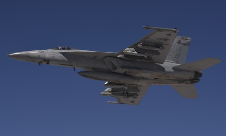 A U.S. Navy F/A-18F Super Hornet flies a combat sortie over Iraq July 2, 2015.