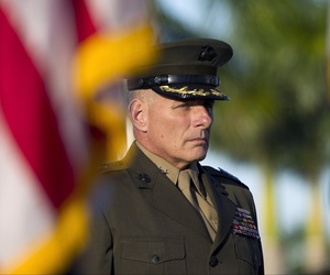 Gen. John F. Kelly stands at attention during the Southern Command change of command ceremony in Miami, Monday, Nov. 19, 2012. Defense Secretary Leon Panetta took part in a leadership change at U.S. Southern Command headquarters.
