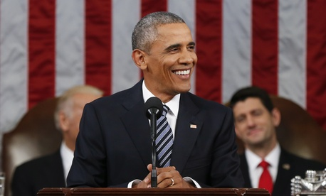 President Barack Obama smiles during his State of the Union address to a joint session of Congress on Capitol Hill in Washington, Tuesday, Jan. 12, 2016.