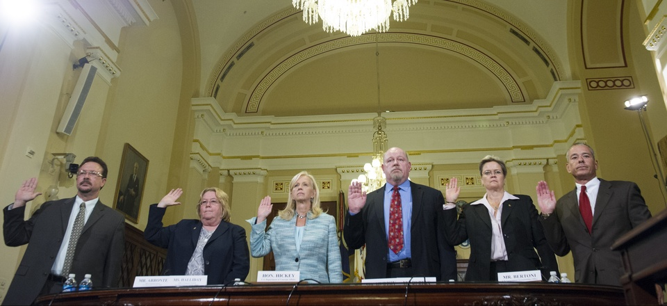 Witnesses are sworn-in before testifying to the House Committee on Veterans' Affairs hearing to review the Veterans Benefits Administrations progress in ending its disability compensation claims backlog by 2015, on Capitol Hill, Monday, July 14, 2014.