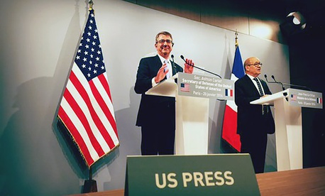French Defense Minister Jean-Yves Le Drian, right, and U.S. Secretary of Defense Ash Carter speak to the press at the Defense Ministry in Paris on Jan. 20, 2016.