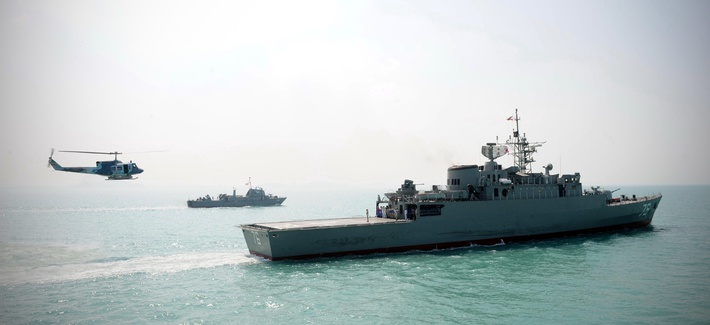 Iran's Jamaran guided-missile destroyer, is seen at right, in an exercise, in the Persian Gulf, Iran, Sunday, Feb. 21, 2010.