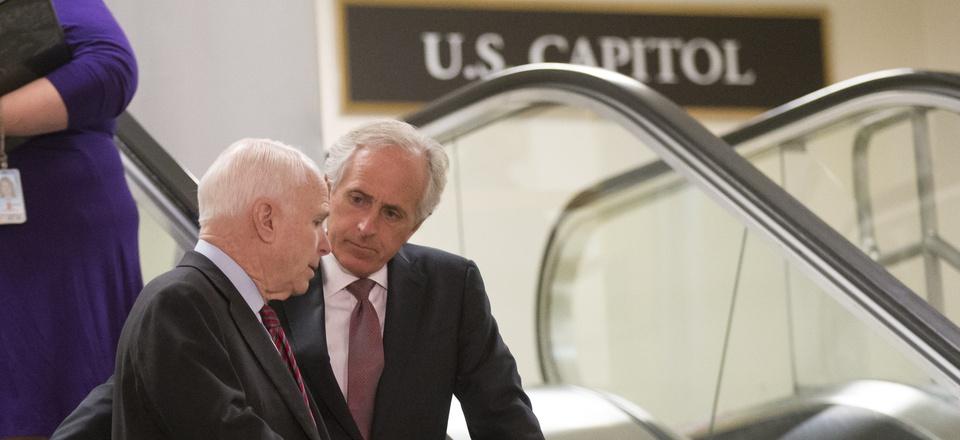 Sen. John McCain, R-Ariz., left, and Sen. Bob Corker, R-Tenn., right, at the Capitol in Washington, Tuesday, Sept. 17, 2013.