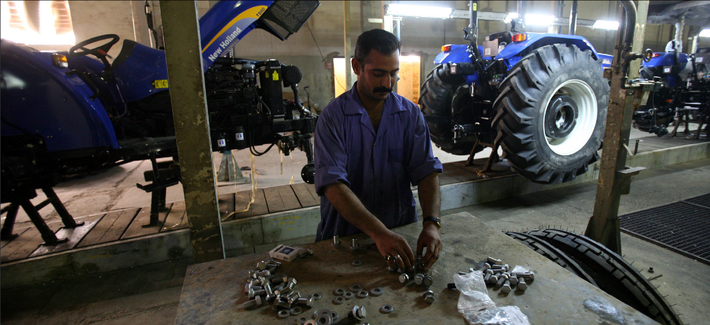A worker assembles parts at a factory of the State Company for Mechanical Industry in Iskandiriyah, Iraq, one of many companies that TFBSO helped draw investors to.