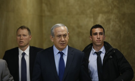 Israel's Prime Minister Benjamin Netanyahu, center, arrives for the weekly cabinet meeting in Jerusalem, Sunday, Dec. 13, 2015.
