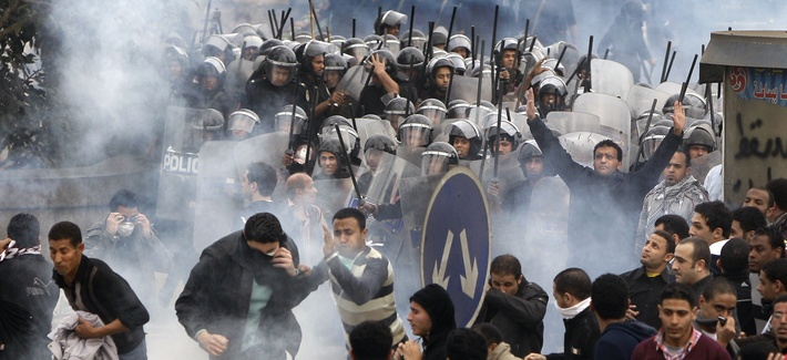 In this Friday, Jan. 28, 2011 file photo, Egyptian anti-government activists clash with riot police in Cairo, Egypt.