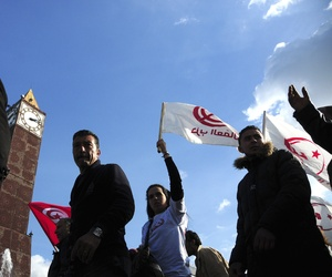 Unemployed tunisian people stage a protest in a precarious calm enforced by a nationwide curfew in Habib Bourguiba avenue, center downtown of Tunis, Saturday Jan. 23, 2016.