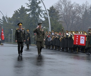 Chairman of the U.S. Joint Chiefs of Staff, Gen. Joseph Dunford, second left, and Turkey's Chief of Staff Gen. Hulusi Akar inspect a military honour guard in Ankara, Turkey, on Jan. 6, 2016.