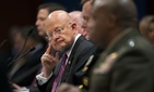 Director of National Intelligence James Clapper listens at center to testimony given by Director of the Defense Intelligence Agency, Lt. Gen. Vincent Stewart, far right, during the House Intelligence Committee hearing on Capitol Hill, Sept. 10, 2015.