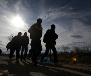Refugees walk towards the border with Serbia from the transit center for refugees near northern Macedonian village of Tabanovce, Friday, Feb. 5, 2016.