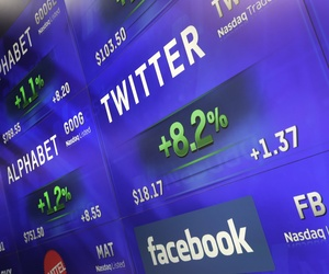 Electronic screens post prices of Alphabet, Twitter and Facebook stock, Monday, Feb. 1, 2016, at the Nasdaq MarketSite in New York. Alphabet, the parent company of Google, reports quarterly earnings.