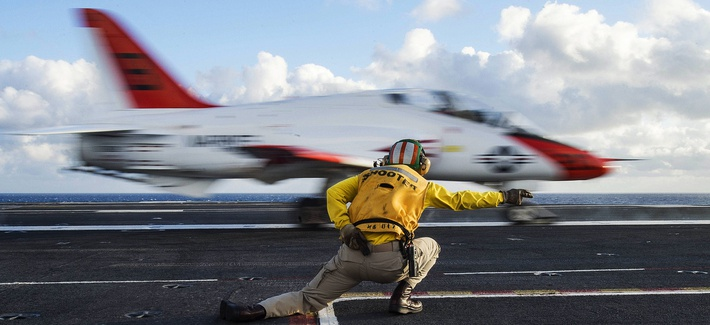 A T-45C Goshawk launches from the aircraft carrier USS Dwight D. Eisenhower, preparing for qualifications in the Atlantic Ocean, Feb. 3, 2016.