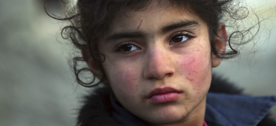 A Syrian child and thousands of others are arriving at the Bab al-Salam border crossing with Turkey, Feb. 6, 2016.