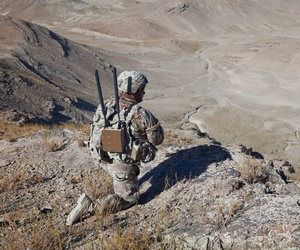 A U.S. Soldier of Bandit Troop 1st (Tiger) Squadron 3rd Cavalry Regiment provides overwatch security while soldiers move up Pride Rock mountain to witness the reenlistment of two U.S. Soldiers in Paktya province, Afghanistan.