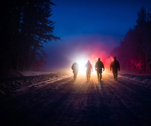 Members of the 354th Fighter Wing inspection team walk toward first responders Jan. 26, 2015, during a major accident response exercise at Eielson Air Force Base, Alaska.