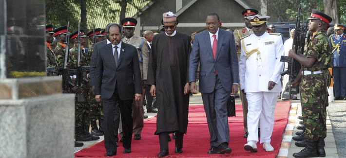 Kenya's President Uhuru Kenyatta, Nigerian President Muhammadu Buhari, center, and Somalia's President Hassan Sheikh Mohamud, at a memorial for Kenyan soldiers killed in Somalia, held at a military barracks in Eldoret, Kenya, Jan. 27, 2016.