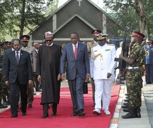 Kenya's President Uhuru Kenyatta, Nigerian President Muhammadu Buhari, center, and Somalia's President Hassan Sheikh Mohamud, at a memorial for Kenyan soldiers killed in Somalia, held at a military barracks in Eldoret, Kenya, Jan. 27, 2016.