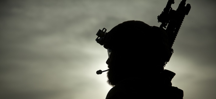 A U.S. Marine special operator assists with security during a construction project for an Afghan Local Police (ALP) checkpoint in Helmand province, Afghanistan, March 30, 2013.