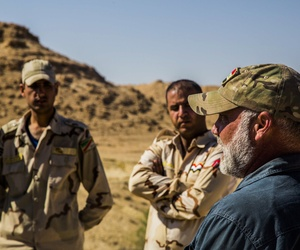 Iraqi Soldiers listen to a civilian contractor attached to Task Force Al Asad, talk about counter-improvised explosive device aboard Al Asad Air Base, Iraq, April 2, 2015.