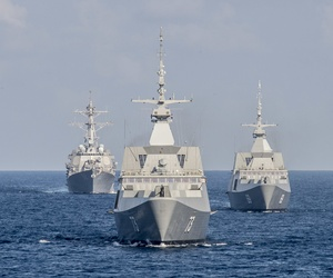 The Republic of Singapore Navy's RSS Intrepid (69), right, RSS Supreme (73), center, and the U.S. Navy destroyer USS Lassen (DDG 82), left, during a military drill in the South China Sea.