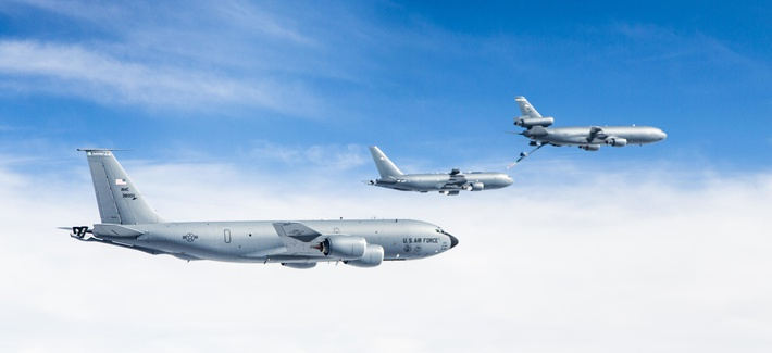Boeing's KC-46A conducting tests of aircraft acceleration and vibration exposure while flying in receiver formation at various speeds and altitudes behind either the KC-10 Extender or the KC-135 Stratotanker, Oct. 19, 2015, over Owens Valle, Calif.