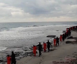 This image made from a video released Sunday Feb. 15, 2015 by militants in Libya claiming loyalty to the Islamic State group before beheading Egyptian Coptic Christians.