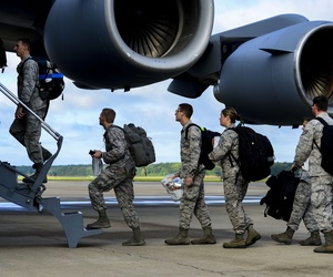 U.S. Air Force airmen assigned to the 633rd Medical Group load onto a C-17 Globemaster at Langley Air Force Base, Va., in 2014, helping to deliver a modular medical treatment center to Ebola-stricken countries.