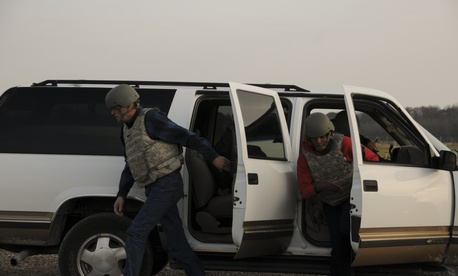 Two civilians rehearse exiting a vehicle under attack at Muscatatuck Training Range, an extension of Camp Atterbury Joint Maneuver Training Center in Edinburgh, Ind., Nov. 7, 2012.