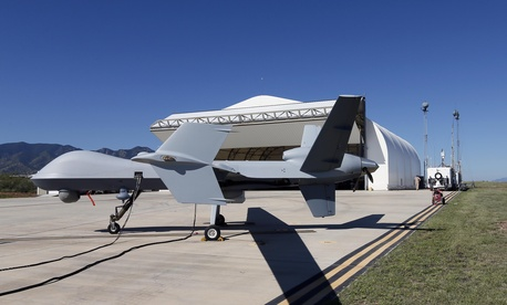 In this Sept. 24, 2014 file photo, a U.S. Customs and Border Patrol drone aircraft is prepped prior to it's flight at Ft. Huachuca in Sierra Vista, Ariz.