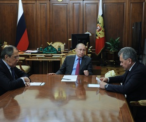 Russian President Vladimir Putin, center, Foreign Minister Sergey Lavrov, left, and Defense Minister Sergey Shoygu, right, meet in the Kremlin in Moscow, Mon., March 14, 2016.