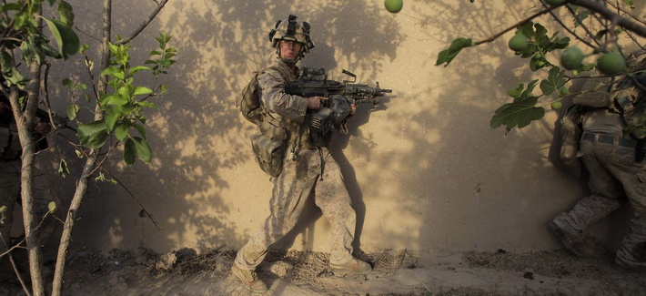 United States Marines from Golf Company, 2nd Battalion, 3rd Regiment, 2nd MEB, move through a compound in the village of Dahaneh during a raid Saturday, Aug. 15, 2009, in the Helmand Province of Afghanistan.