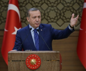 Turkish President Recep Tayyip Erdogan addresses a meeting of local administrators at his palace in Ankara, Turkey, Wednesday, March 16, 2016.