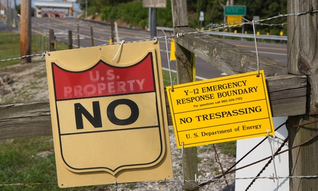 Signs warn against trespassing onto the Y-12 National Security Complex in Oak Ridge, Tenn., on Friday, Aug. 17, 2012.