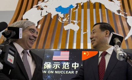 U.S. Secretary of Energy Ernest Moniz, left, and Chairman Xu Dazhe of the Chinese Atomic Energy Authority at the Nuclear Security Center of Excellence in Beijing on March 18, 2016.