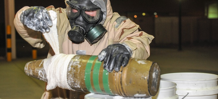An EOD expert wraps the ordinance in an attempt to seal a 'dirty bomb,' so that it will not continue to leak out hazardous material, June 3, 2013.