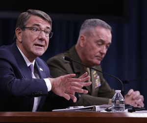 Defense Secretary Ash Carter, accompanied by Joint Chiefs Chairman Gen. Joseph Dunford, speaks during a news conference at the Pentagon, Friday, March 25, 2016.