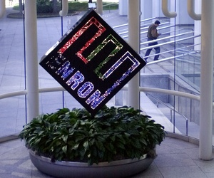 A colorful revolving Enron Corp. logo spins in the lobby of the enrgy company's downtown Houston headquarters in a file photo from Feb. 11, 2002, as an unidentified man enters the building.