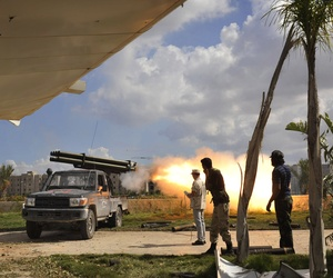 Libyan revolutionary fighters launch a missile towards pro-Gadhafi forces in downtown Sirte, Libya, Friday, Oct. 14, 2011.