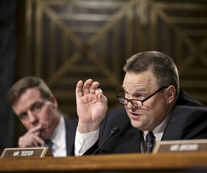 Sen. Jon Tester, D-Mont., Thursday, Nov. 14, 2013, on Capitol Hill in Washington.