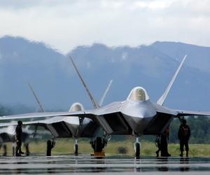 Lockheed Martin F-22 Raptors line up on a runway in 2006.