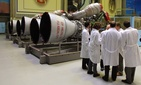 Energomash company employees stand near RD-180 engines prepared for shipment to the United States in a shop at the Energomash, leading Russian rocket engine company, in Moscow, June 6, 2002.