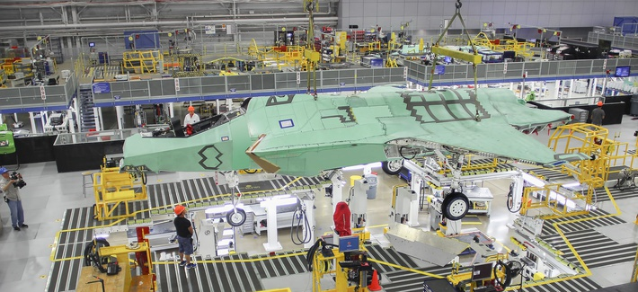 Norway's first F-35 is lifted by an overhead crane in Lockheed Martin's assembly plant in Fort Worth in April 2015.
