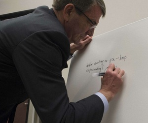 Defense Secretary Ash Carter signs the guest board at Galvanize San Francisco in March.