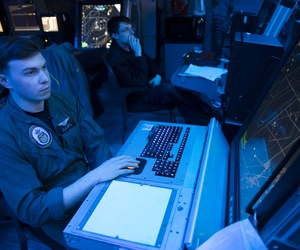 A U.S. sailor simulates an approach control watch in the amphibious air traffic control center aboard the amphibious assault ship USS Bonhomme Richard (LHD 6), somewhere in the U.S. 7th Fleet area of operations, March 20, 2016.
