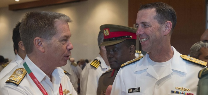 Chief of Naval Operations Adm. John Richardson (CNO) talks with the head of the Royal Australian Navy, Chief of Navy Vice Adm. Tim Barrett, during India's International Fleet Review (IFR) 2016.