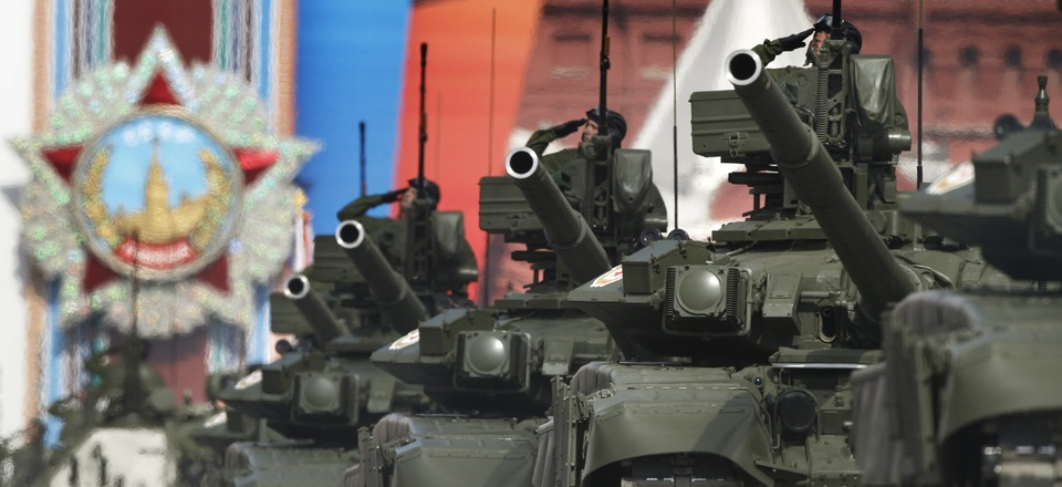 Russian tanks T-90 drive through the Red Square during the Victory Day Parade, which commemorates the 1945 defeat of Nazi Germany in Moscow, Russia, Monday, May 9, 2011, with a display depicting the Order of the Victory in the background.