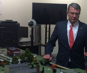 Defense Secretary Ash Carter looks over the CberCity simulator at the Air Force Academy, taken May 12, 2016.