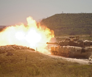A burst of fire erupts from the muzzle of a 2nd Armored Brigade Combat Team in a training exercise in 2014.