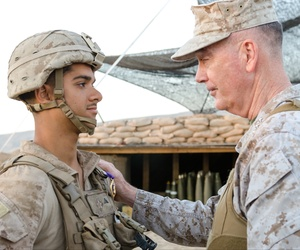 On April 22, Chairman of the Joint Chiefs of Staff Gen. Joseph Dunford presents U.S. Marine Lance Cpl. Javier A. Suarezmontalvo, with a Purple Heart for injuries sustained on March 19 at Kara Soar Base, Makhmur, Iraq.