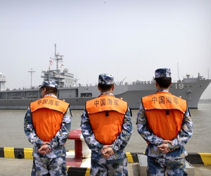 In May, U.S. and Chinese generals agreed to work toward rules to avoid confrontation in the South China Sea. Pictured, People's Liberation Army (PLA) Navy sailors watch the USS Blue Ridge arrive in Shanghai, May 6, 2016.